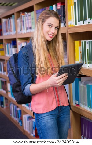 Student using tablet in library at the university
