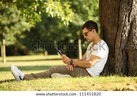 student using web on his tablet - stock photo