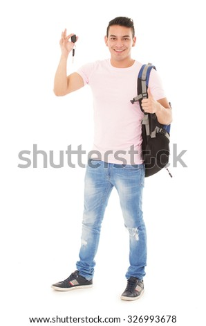 student wearing a backpack with car keys on a white background - stock photo