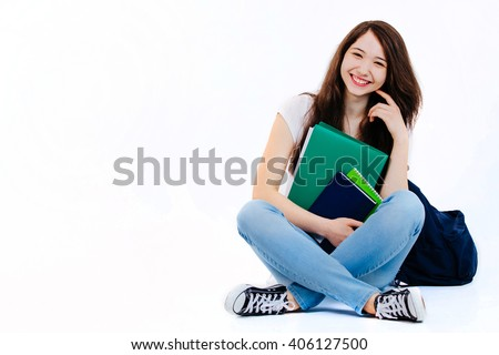 Student with backpack and books on white background. - stock photo
