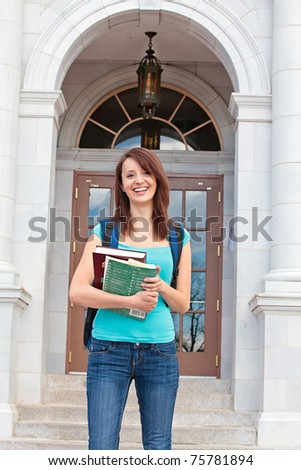 Student with books on campus