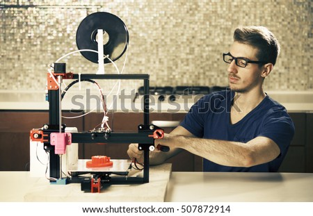 student with 3D printer