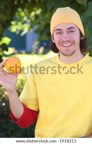 student with orange - stock photo