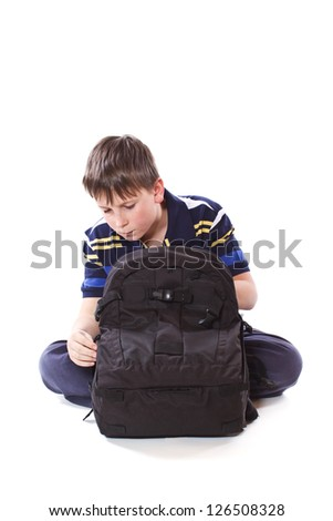 student with school bag on a white background - stock photo