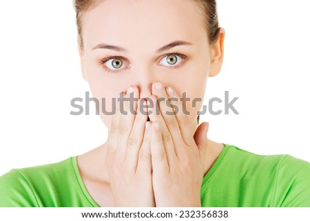 Student woman covering her mouth because of shame. - stock photo