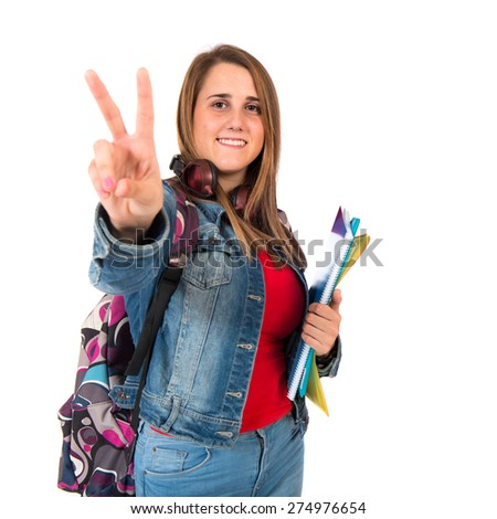 Student woman making Ok sign over white background - stock photo
