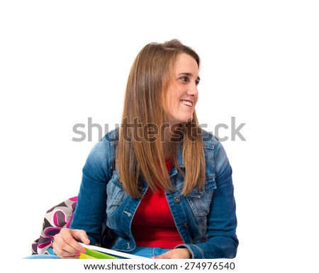 Student woman over isolated white background - stock photo