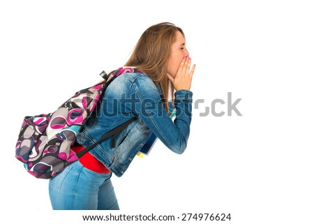 Student woman shouting at her friend - stock photo