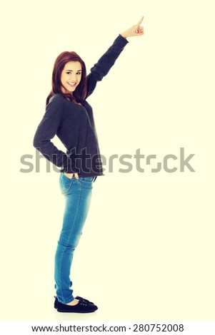 Student woman showing copyspace or something - stock photo
