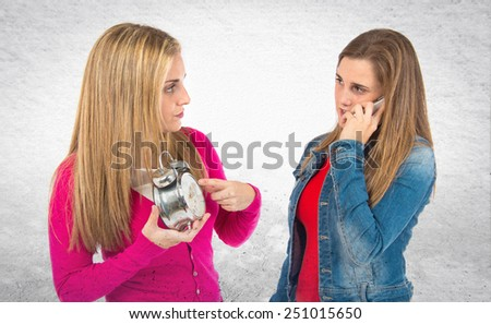 Student woman talking to mobile over textured background - stock photo