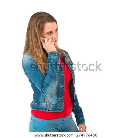 Student woman talking to mobile over white background - stock photo