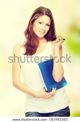 Student woman with note pad and pen