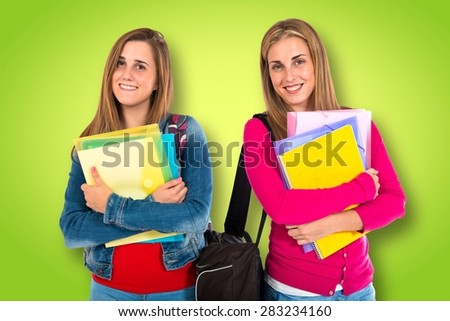 Student women over colorful background - stock photo