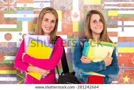 Student women over flags background - stock photo
