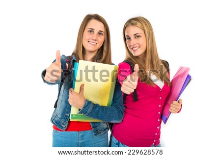 Student women with thumb up over white background - stock photo