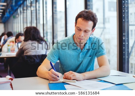 student working in the library - stock photo