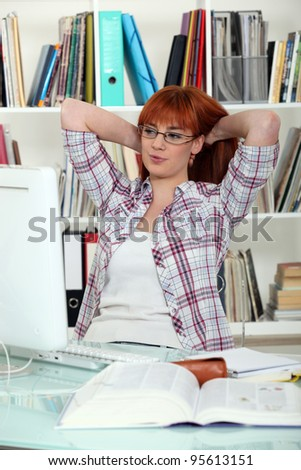 student working on her computer - stock photo