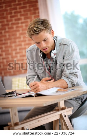 Student working on laptop computer - stock photo