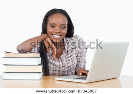 Student working with a laptop against a white background