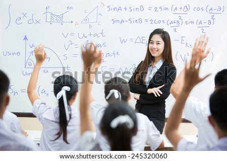 Students answer the teacher's questions in science. And mathematics in the classroom - stock photo