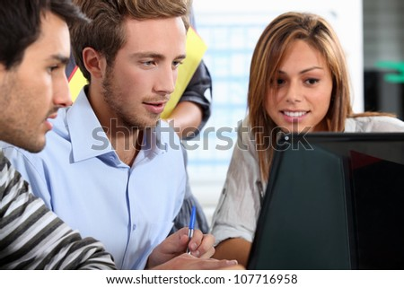 Students around a computer - stock photo