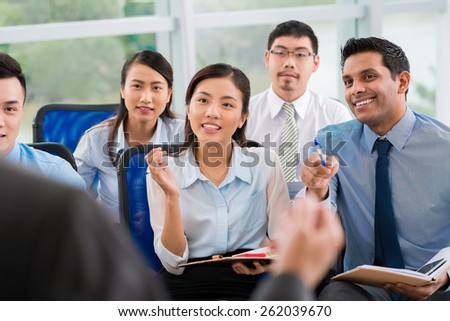 Students asking questions at lecture - stock photo