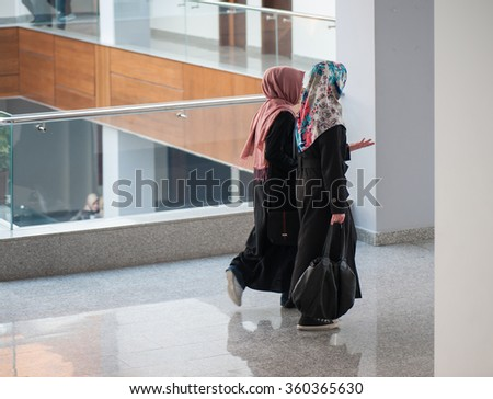 Students at modern university - stock photo