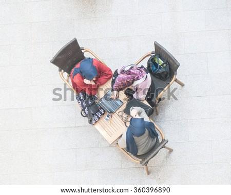 Students at modern university - stock photo
