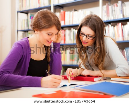 Students at work in a library - stock photo