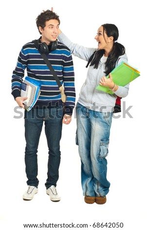 Students couple having fun and laughing together isolated on white background - stock photo