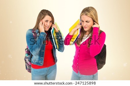 Students covering her ears over ocher background