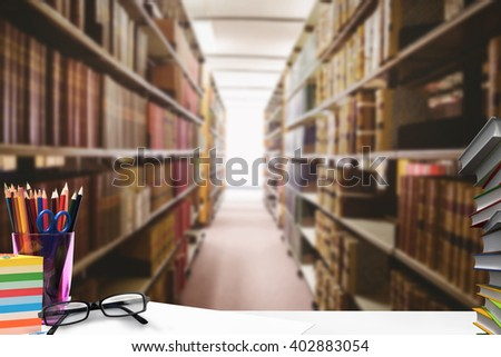 Students desk against close up of a bookshelf - stock photo