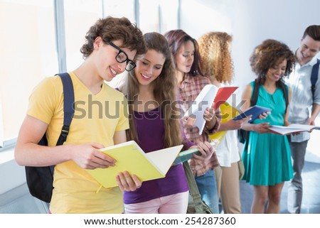 Students discussing their class notes at the college