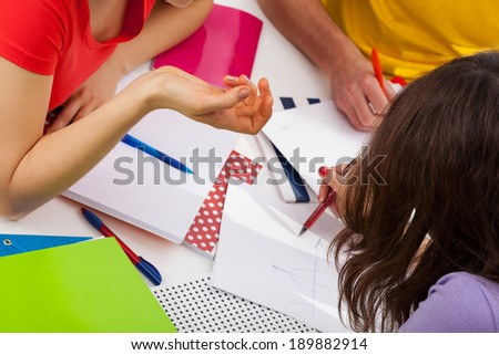 Students doing their homework in common, horizontal - stock photo