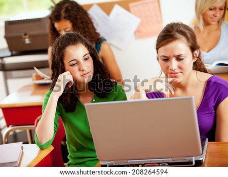 Students: Friends Working Together On Class Project - stock photo