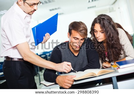 Students getting lecture from professor - stock photo