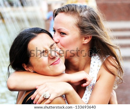 Students girls having fun outside. - stock photo