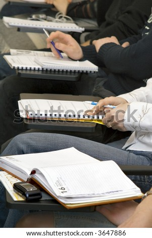 Students in a classroom at the lecture - stock photo