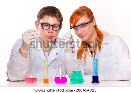 Students in chemistry lab doing reactions - studio shoot  - stock photo