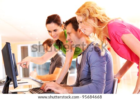 Students in computing training class - stock photo