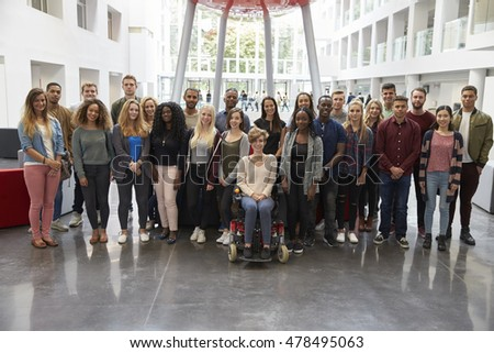 Students in modern university building, large group portrait