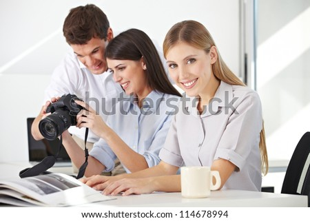 Students in photo class with photographer with camera and lenses - stock photo