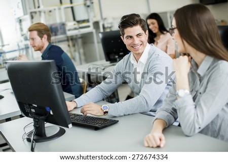 Students in the classroom - stock photo