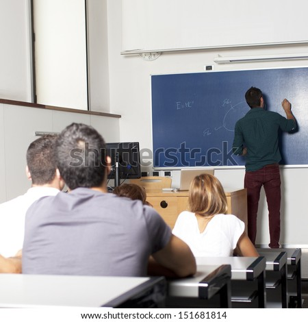 Students in the lecture hall - stock photo