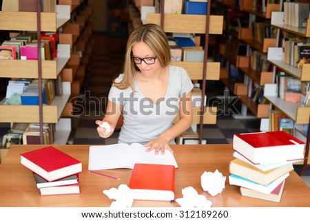 students learns in a library and enjoy - stock photo