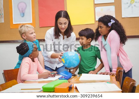 Students listening to the teacher at the elementary school - stock photo