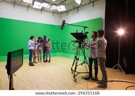 Students On Media Studies Course In TV Studio - stock photo