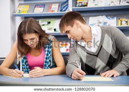 Students passing a test - stock photo