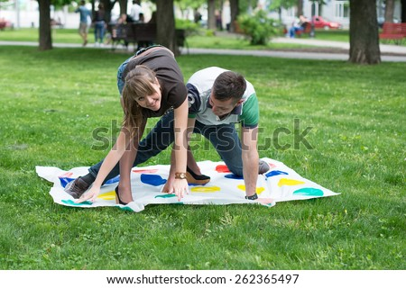 Students play a game in the park twister,