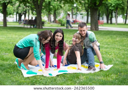 Students play a game in the park twister,  - stock photo